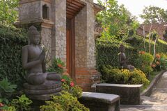 Free Door Or Gate To Enter Into Traditional Balinese Garden Lanscaping And Budha Statues Royalty Free Stock Photography - 174461387