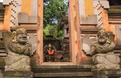 Free Door Or Gate To Enter Into Traditional Balinese Garden Lanscaping Detail With Statues Stock Image - 174461461