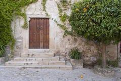 Door of the orange trees. In Trujillo, Spain Royalty Free Stock Photos