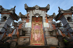 Door with ornament in the Indonesian temple. At sunrise, Bali Royalty Free Stock Photos