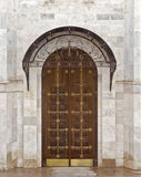 Doors. The door of the Orthodox temple on a background stone wall royalty free stock photo