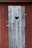 Door on outdoor toilet Stock Photo