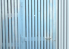 Door panels and a white picket fence with blue or wood texture Stock Photo