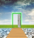 Door passage to nature from wasteland Royalty Free Stock Photo