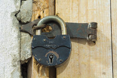 Door in the past.  Old lock. Door in the past.  Old padlock Stock Photos