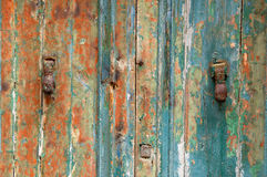 Door peeling. Peeling door damaged from weather and the passage of time Royalty Free Stock Photos
