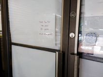 Business Closed After 50 Years, Rutherford, NJ, USA. In the door of a recently closed shoe store, a sign reads, `Thank you for the past 50 years... We will miss Stock Photos