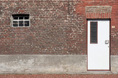 Door in a red brick wall Royalty Free Stock Images