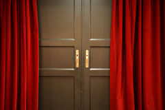 Door & Red Curtains. Wooden Door and Red Curtains Royalty Free Stock Image