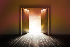 Door revealing bright light Royalty Free Stock Photography