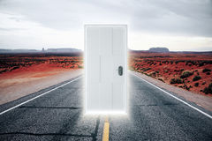 Door on the road to a parallel world with a glow Stock Image