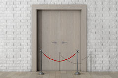 Door with Rope Barrier in front of Brick Wall Stock Photography
