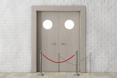Door with Rope Barrier in front of Brick Wall Stock Photo