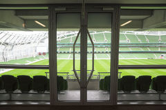 Door and rows ofseats in stadium Royalty Free Stock Image