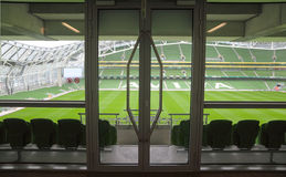 Door and rows of seats in stadium Royalty Free Stock Photography