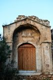 Door and ruin. Ruin of ancient building in Athens, Greece Royalty Free Stock Photography
