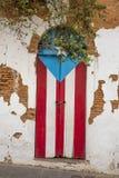 Door of a ruined house in San Juan, Puerto Rico. Puerto Rican flag painted on the door of a ruined house in San Juan, Puerto Rico Stock Photography
