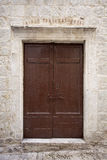 Door rustic brown in stone hous Stock Images