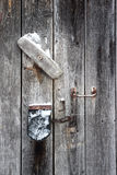 The door with rusty handle and padlock Royalty Free Stock Photo