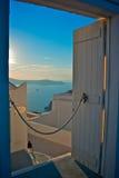 Through a door in Santorini. Looking through a hotel entrance door in Santorini Greece overlooking the Mediterranean Sea Royalty Free Stock Images