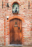 Door with a sculpture of the dog royalty free stock photography