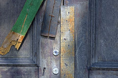 Door sealed with wooden slats Stock Image