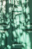 Door with shadows Stock Image