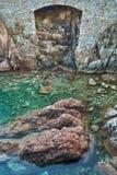 Door shaped hole at the rocky coast stock image