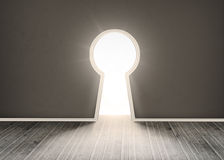 Door shaped keyhole showing bright light Royalty Free Stock Image