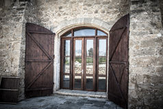 Door with shuttered in an old stone building Stock Images