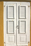Door shutters. Of traditional home on Bonaire royalty free stock images