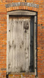 Door in side of barn. Old Wooden Door in the side wall of a Barn Royalty Free Stock Images