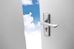 Door and sky. An opened door with blue sky background Stock Photo
