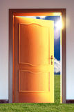 Door and sky with sun. Opened door to blue sky with sun and grass - conceptual image Stock Photos