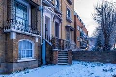 Winter sunrise in snowy suburb in London. Door in snowy suburb in London Royalty Free Stock Image
