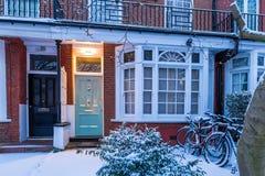 Winter sunrise in snowy suburb in London. Door in snowy suburb in London Stock Image