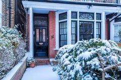 Winter sunrise in snowy suburb in London. Door in snowy suburb in London Stock Images