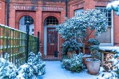 Winter sunrise in snowy suburb in London. Door in snowy suburb in London Stock Photo