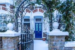 Winter sunrise in snowy suburb in London. Door in snowy suburb in London Royalty Free Stock Photo