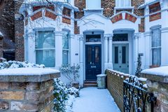 Winter sunrise in snowy suburb in London. Door in snowy suburb in London Royalty Free Stock Photography