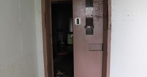 Opening prison door with sound. Door of solitary confinement cell opening to cell block hallway in old prison with sound stock video