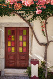 Door with stained glass windows. And a blossoming tree royalty free stock photos