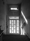 Door with stairs. In a old abandoned house Stock Photo