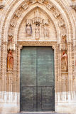 Door and statues, Spain Stock Photography