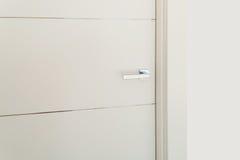 Door with steel handle Stock Images
