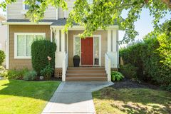 Free Door Steps And Concrete Pathway Leading To Residential House Main Entrance Royalty Free Stock Image - 153849446