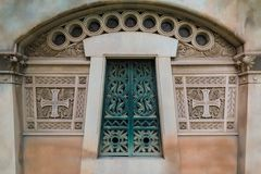 Door of crypt. The door of the stone crypt on the Montjuic Cemetery closeup front view, Barcelona, Catalonia, Spain stock images