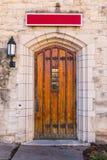 Door on stone facade Stock Images