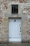 The door of a stone house in Saché, France, was painted in white Stock Image