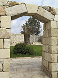 Door of stone with keystone. Stone wall and door with arch and keystone in a courtyard of a farm in italy stock photo